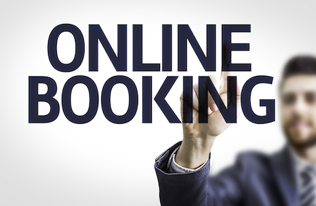 Business man pointing the text: Online Booking